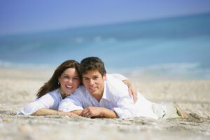How Attachment Influences Intimate Relationships - Couple lying on the beach